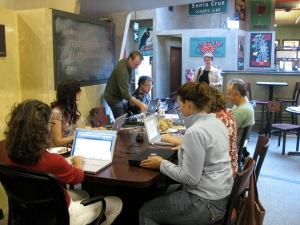 Members sitting in the Cafe at NextSpace actively blogging.